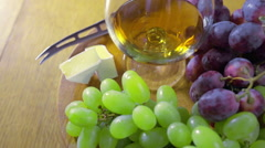 A composition with a glass of brandy grapes brie cheese Stock Footage