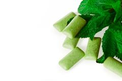 Green chewing gum on white - food and drink Stock Photos