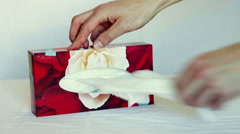 A man gets out of the box with a cloth napkins Stock Footage