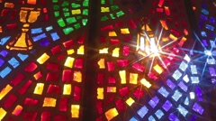 Camera moves (Dolly) across stained glass window - stock footage