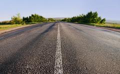 Stock Photo of asphalt road in summer day