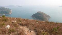 Climb down the trail on sandy dry rocky hill of Ap Lei Chau Island Stock Footage