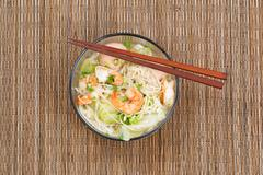 Hot spicy Chinese noodle soup in glass bowl Stock Photos