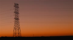 Energy Transmission Power Line Tower Pylon Structures at Sunset Stock Footage