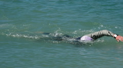 Swimmer coming to the end of the route in a competition swimming in a lake Stock Footage