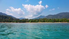 view of the tropical island from the sea - stock photo