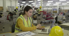 A female warehouse manager with a laptop Stock Footage