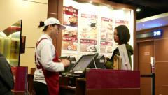 Client make order to cashier, cashier receive money Stock Footage