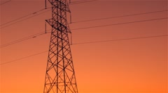Energy Transmission Power Line Tower Pylon Structures at Sunset - stock footage