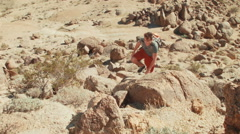 Hiker Climbing Up Rocky Mountain 5 - stock footage