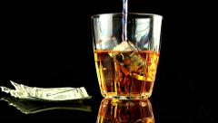Rotating glass pouring liquor alcohol rocks black background people lifestyle Stock Footage