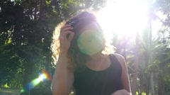 Summer Happy Girl on Sunny Day Outside in Park. Slow Motion Stock Footage