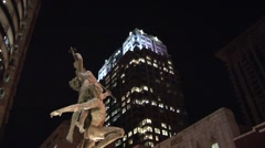 ORLANDO DOWNTOWN NIGHT STATUE and HIGH-RISE Stock Footage