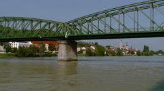 Sailing under bridge on Danube River in the Wauchau Valley Stock Footage