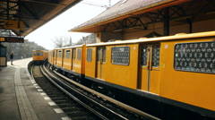 Yellow tram arrives at station Berlin Stock Footage