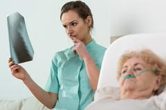 Analysing old woman's X-Ray Stock Photos