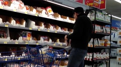 Man selecting ham in grocery store Stock Footage