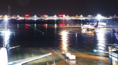 Time Lapse of Haneda Tokyo International Airport in Rain at Night -Long Shot- Stock Footage
