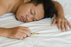 drug addict laying on the bed - stock photo