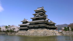 Cherry blossoms at Matsumoto Castle, Nagano Prefecture, Japan Stock Footage