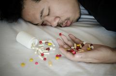 Drug addict laying on the bed Stock Photos