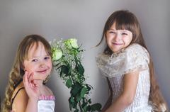 Girls are holding flowers - stock photo