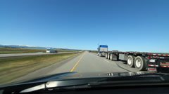 Passing flatbed truck in Alberta, Canada. Stock Footage