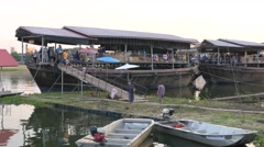 Shopping sale on old boats at Songkran,Ubon Ratchathani,Thailand Stock Footage