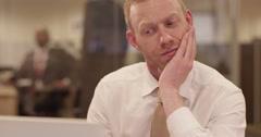 A stressed businessman fighting deadline. - stock footage