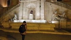 Girl is coming to Fontana della Dea Roma. Night. Rome, Italy. 4K Stock Footage