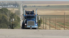 Blue truck at intersection in Alberta, Canada. Trucks passing. Stock Footage