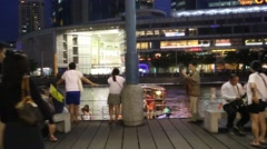 People relax on the waterfront of Singapore river Stock Footage