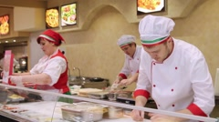 RUSSIA, MOSCOW, 7 MARCH 2015, chefs baker and pizza cook in uniform at pizzeria Stock Footage