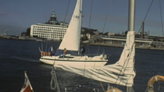 Helsinki 1987: boat sailing in the baltic sea in front of the city Stock Footage