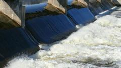 Rushing Waters Glide Over Dam in Spring Stock Footage