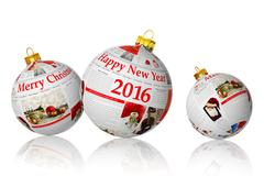 Christmas articles on newspaper balls isolated on white background - stock photo