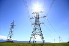 Electric Power Transmission Lines under the sun Stock Photos