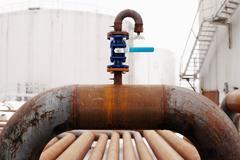 Blue valve on rusty piping Stock Photos