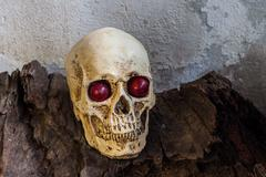 Human skull with red eye Stock Photos
