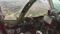 the pilot in the cockpit of a military aircraft - stock footage