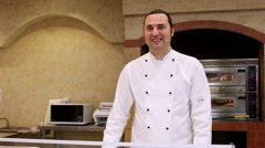 RUSSIA, MOSCOW, 7 MARCH 2015, Smiles Italian Chef baker in white uniform at the Stock Footage