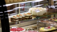 Showcase of cakes,  pastry in window display canteen for sale tasty desert food Stock Footage