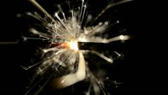Closeup of Sparkler in the dark lit by Hand Stock Footage
