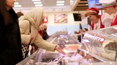 RUSSIA, MOSCOW, 7 MARCH 2015, buyer points to a specific product, chooses to buy Stock Footage