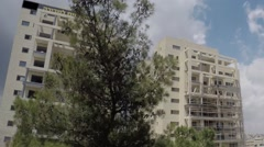 Fast timelapse Dismounting a scaffold of a big building in Jerusalem Stock Footage