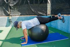 Prone hip extension exercise - stock photo