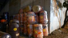 Many trash can stored near the wall corner. New and packed in plastic Stock Footage