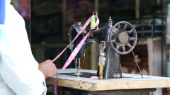 Man preparing to work on a sewing machine. Stock Footage