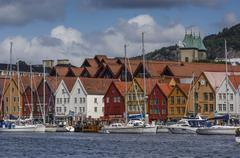 Stock Photo of BERGEN/NORWAY 10TH JULY 2006 Yachts in the harbour with Bryggen in the backgr