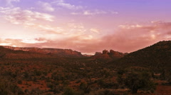 Time lapse clip of sunset over Red Rocks in Sedona, Arizona Stock Footage